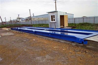 Автомобильные весы ВАЛ с бетонными въездными пандусами и оборудованной будкой весовщика. фото #27
